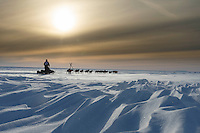 Ken Anderson on the trail several miles from the Nome finish line near sunset on Wednesday March 17, 2015 during Iditarod 2015.  <br /> <br /> (C) Jeff Schultz/SchultzPhoto.com - ALL RIGHTS RESERVED<br />  DUPLICATION  PROHIBITED  WITHOUT  PERMISSION