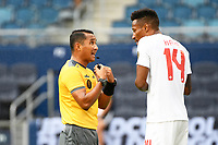 KANSASCITY, KS - JULY 11: Referee Ivan Barton talks with Mark-Anthony Kaye #14 of Canada during a game between Canada and Martinique at Children's Mercy Park on July 11, 2021 in KansasCity, Kansas.