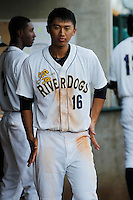 Charleston RiverDogs infielder Gosuke Katoh (16) in the dugout during a game against the Hickory Crawdads at Joseph P. Riley Jr. Ballpark on May 2, 2015 in Charleston, South Carolina. Hickory defeated Charleston  4-1. (Robert Gurganus/Four Seam Images)