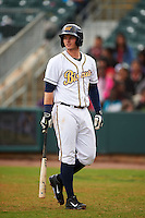Montgomery Biscuits shortstop Daniel Robertson (4) walks back to the dugout during a game against the Jackson Generals on April 29, 2015 at Riverwalk Stadium in Montgomery, Alabama.  Jackson defeated Montgomery 4-3.  (Mike Janes/Four Seam Images)