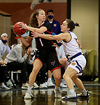 SIOUX FALLS, SD - MARCH 8: Sarah Schmitt #1 of the Omaha Mavericks looks for help while being guarded by Elizabeth Lutz #14 of the Western Illinois Leathernecks during the Summit League Basketball Tournament at the Sanford Pentagon in Sioux Falls, SD. (Photo by Dave Eggen/Inertia)