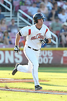 Jonathan Jones #23 of the Salem-Keizer Volcanoes runs to first base during a game against the Spokane Indians at Volcanoes Stadium on July 26, 2014 in Keizer, Oregon. Spokane defeated Salem Keizer, 4-1. (Larry Goren/Four Seam Images)