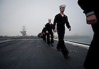 111130-N-DR144-454 CORONADO, Calif.  (Nov. 30, 2011) Sailors man the rails as Nimitz-class aircraft carrier USS Carl Vinson (CVN 70) prepares to depart Naval Air Station North Island for a Western Pacific Deployment. (U.S. Navy photo by Mass Communication Specialist 2nd Class James R. Evans/Released).