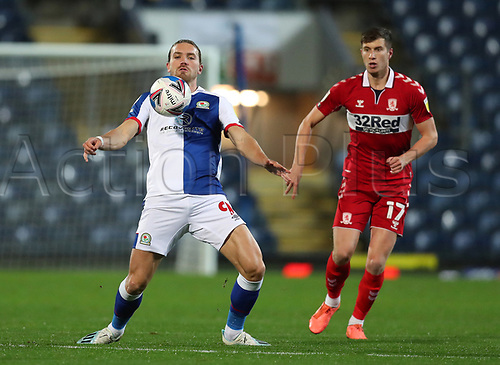 3rd November 2020; Ewood Park, Blackburn, Lancashire, England; English Football League Championship Football, Blackburn Rovers versus Middlesbrough; Sam Gallagher of Blackburn Rovers controls the ball on his chest as Paddy McNair of Middlesbrough looks on