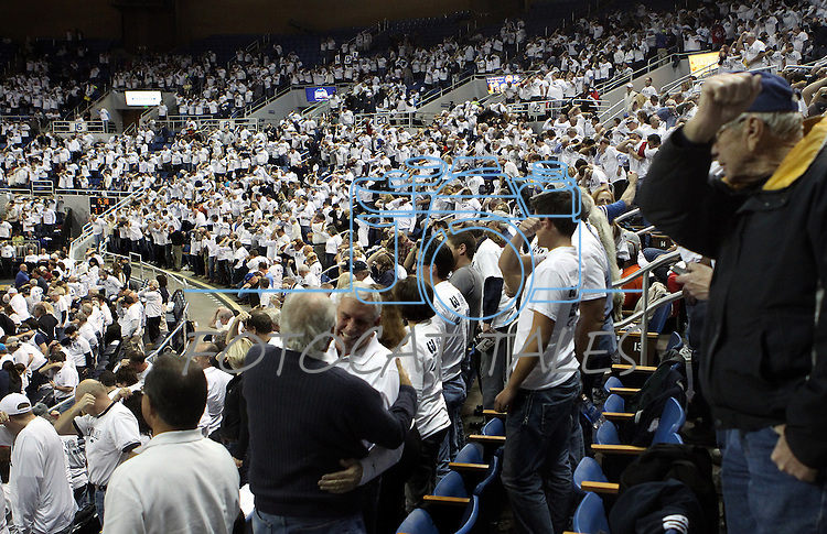 """Nevada fans show their support for quarterback Colin Kaepernick by """"Kaepernicking"""" for 15-seconds during the NCAA men's basketball game between San Diego State and Nevada, on Wednesday, Jan. 23, 2013 in Reno, Nev. Kaepernick graduated from Nevada in 2011. (AP Photo/Cathleen Allison)"""