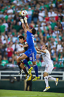Pasadena, CA - June 25, 2011: Mexico goalkeeper Luis Michel makes a save in front of  United States' Landon Donovan during the 2011 CONCACAF Gold Cup Championships, at the Rose Bowl. Mexico won 4-2.