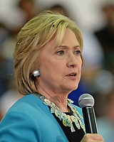 DAVIE, FL - OCTOBER 02: Hillary Clinton Speech Apparently Attracts Flies As One Lands On Her Head in Florida. Democratic presidential candidate Hillary Clinton speaks during her campaign stop at the Broward College Hugh Adams Central Campus on October 2, 2015 in Davie, Florida. Hillary Clinton continues to campaign for the nomination of the Democratic Party as their presidential candidate.<br /> <br /> <br /> People:  Hillary Clinton