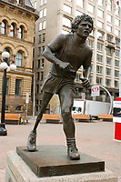 """Statue of Terry Fox in..Ottawa, Capital of Canada....In 1980, Terry Fox, who had lost a leg to cancer, began a coast-to-coast journey across Canada to raise money for cancer research. His """"Marathon of Hope"""" ended with his collapse just outside of Thunder Bay, Ontario. He died less than a year later. The memory of his courage leads 500,000 Canadians each year to participate in the Terry Fox Run held to carry on Terry's quest for a cure for cancer....photo : (c)  Images Distribution.."""