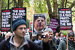 © Joel Goodman - 07973 332324 - all rights reserved . 06/11/2010 . London , UK . A large placard featuring a distorted face of BNP leader Nick Griffin is carried in the crowd . Unite Against Fascism ( UAF ) hold a demonstration and march against racism, fascism and homophobia , with a march and rally through Westminster . Photo credit : Joel Goodman