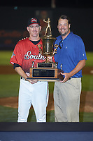 South Division manager Joe Ayrault of the Carolina Mudcats is presented with the 2018 Carolina League All-Star Classic trophy by Carolina League President Geoff Lassiter at Five County Stadium on June 19, 2018 in Zebulon, North Carolina. The South All-Stars defeated the North All-Stars 7-6.  (Brian Westerholt/Four Seam Images)
