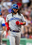Jun 22, 2019; Boston, MA, USA; Toronto Blue Jays shortstop Freddy Galvis returns to the dugout after hitting a 2-run home run in the 7th inning against the Boston Red Sox at Fenway Park. Mandatory Credit: Ed Wolfstein-USA TODAY Sports