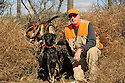 00975-016.05 Labrador Retriever: Huntr and Black Lab are posing with three bagged ring-necked pheasants.  Hunt, roosters.