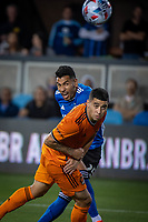 SAN JOSE, CA - JULY 24: Andres Rios #25 of the San Jose Earthquakes heads the ball past Matias Vera #22 of the Houston Dynamo during a game between San Jose Earthquakes and Houston Dynamo at PayPal Park on July 24, 2021 in San Jose, California.