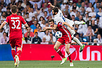 Nacho Fernandez (top) of Real Madrid battles for the ball with Thomas Muller of FC Bayern Munich during their 2016-17 UEFA Champions League Quarter-finals second leg match between Real Madrid and FC Bayern Munich at the Estadio Santiago Bernabeu on 18 April 2017 in Madrid, Spain. Photo by Diego Gonzalez Souto / Power Sport Images