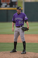 Colorado Rockies relief pitcher Jesse Lepore (34) looks to his catcher for the sign during an Extended Spring Training game against the Arizona Diamondbacks at Salt River Fields at Talking Stick on April 16, 2018 in Scottsdale, Arizona. (Zachary Lucy/Four Seam Images)