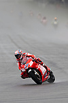 KUALA LUMPUR, MALAYSIA - OCTOBER 25:  Casey Stoner of Australia rides the #27 Ducati Marlboro Team Ducati to win the Malaysian MotoGP, which is round 16 of the MotoGP World Championship at the Sepang Circuit on October 25, 2009 in Kuala Lumpur, Malaysia. Photo by Victor Fraile / The Power of Sport Images