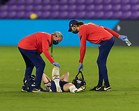 ORLANDO, FL - JANUARY 22: USWNT trainers attend an injured Sam Mewis #3 during a game between Colombia and USWNT at Exploria stadium on January 22, 2021 in Orlando, Florida.