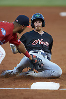 Connor Capel (11) of the Lynchburg Hillcats is tagged out at third base by Abraham Toro (34) of the Buies Creek Astros during the 2018 Carolina League All-Star Classic at Five County Stadium on June 19, 2018 in Zebulon, North Carolina. The South All-Stars defeated the North All-Stars 7-6.  (Brian Westerholt/Four Seam Images)