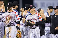 Mitch Roman (10) of the Kannapolis Intimidators high fives his teammates following their win over the Hickory Crawdads in game two of a double-header at Kannapolis Intimidators Stadium on May 19, 2017 in Kannapolis, North Carolina.  The Intimidators defeated the Crawdads 9-1.  (Brian Westerholt/Four Seam Images)