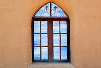 San Geronimo Church window in Pueblo de Taos. Taos, New Mexico.
