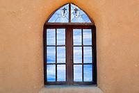 San Geronimo Church window in Pueblo de Taos. Taos, New Mexico.