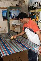 Tripoli, Libya - Male Weaver Moistening Fabric, Tripoli Medina
