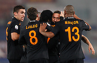 Calcio, semifinale di andata di Coppa Italia: Roma vs Napoli. Roma, stadio Olimpico, 5 febbraio 2014.<br /> AS Roma forward Gervinho, of Ivory Coast, third from right, bvack to camera, celebrates with teammates after scoring during the Italian Cup first leg semifinal football match between AS Roma and Napoli at Rome's Olympic stadium, 5 February 2014. At bottom, Napoli goalkeeper Jose' Manuel Reina, of Spain, lies on the pitch.<br /> UPDATE IMAGES PRESS/Riccardo De Luca