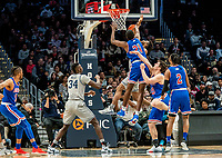 WASHINGTON, DC - DECEMBER 28: Josh Alexander #21 of American defends a shot by Jagan Mosely #4 of Georgetown. during a game between American University and Georgetown University at Capital One Arena on December 28, 2019 in Washington, DC.