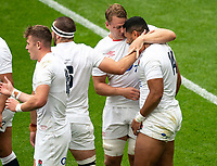 Joe Cokanasiga (Bath Rugby) of England celebrates his 1st try with Alex Dombrandt (Harlequins) of England during the Autumn International match between England and Canada at Twickenham Stadium, London, England on 10 July 2021. Photo by Liam McAvoy.