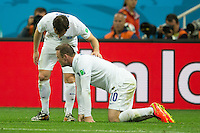 Wayne Rooney of England looks dejected with Leighton Baines