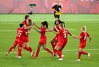 YOKOHAMA, JAPAN - AUGUST 6: Julia Grosso #7 of Canada celebrates with teammates during a game between Canada and Sweden at International Stadium Yokohama on August 6, 2021 in Yokohama, Japan.