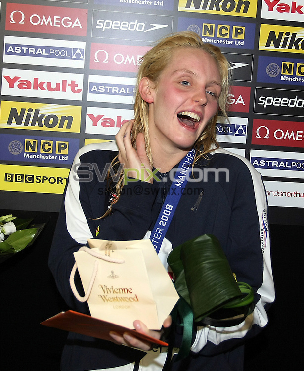 PICTURE BY VAUGHN RIDLEY/SWPIX.COM - Swimming - World Short Course Swimming Championships 2008 - Day Four, Finals -  Manchester, England - 12/04/08...Copyright - Simon Wilkinson - 07811267706..Great Britain's Francesca Halsall receives a surprise birthday cake after the evening Finals session.