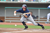 Mississippi Braves center fielder Kyle Wren #14 lays down a bunt during a game against the Tennessee Smokies at Smokies Park on July 21, 2014 in Kodak, Tennessee. The Braves defeated the Smokies 4-3. (Tony Farlow/Four Seam Images)