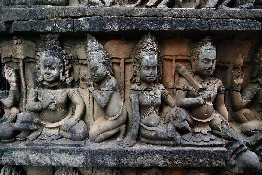 Sandstone bas relief of male figures, Devatas of the underworld on the hidden wall at the Leper King Terrace, part of the Royal Square of Angkor Thom  - Angkor Wat, Siem Reap, Cambodia...