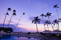 Pool area at the Halekulani Hotel in Waikiki, at dusk