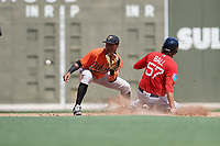 Baltimore Orioles shortstop Jean Carmona (52) waits to receive a throw as Trey Ball (57) slides into second base during a Florida Instructional League game against the Boston Red Sox on September 21, 2018 at JetBlue Park in Fort Myers, Florida.  (Mike Janes/Four Seam Images)