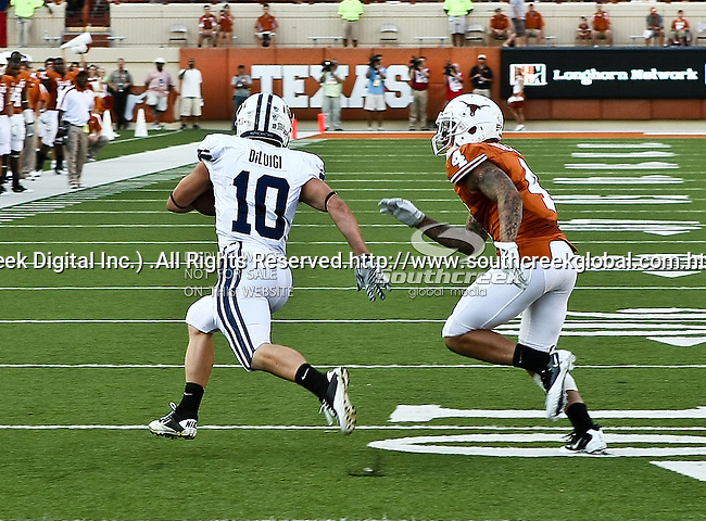 Brigham Young Cougars running back JJ Di Luigi (10) and Texas Longhorns safety Kenny Vaccaro (4) in action during the game between the Brigham Young Cougars and the Texas Longhorns at the Darrell K Royal - Texas Memorial Stadium in Austin, Texas. Texas defeats Brigham Young 17 to 16...