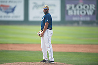 Helena Brewers relief pitcher Roberto Delgado (43) prepares to deliver a pitch during a Pioneer League game against the Grand Junction Rockies at Kindrick Legion Field on August 19, 2018 in Helena, Montana. The Grand Junction Rockies defeated the Helena Brewers by a score of 6-1. (Zachary Lucy/Four Seam Images)