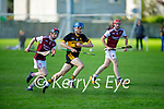 Dr Crokes Kieran O'Connor on a solo run as he slips past Dylan Murphy of Causeway in the 2021 Junior Hurling Championship final