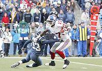 27 Nov 2005:   New York Giants  wide receiver Plaxico Burress breaks free from Seattle Seahawks corner back Marcus Trufant at Quest Field in Seattle, WA.