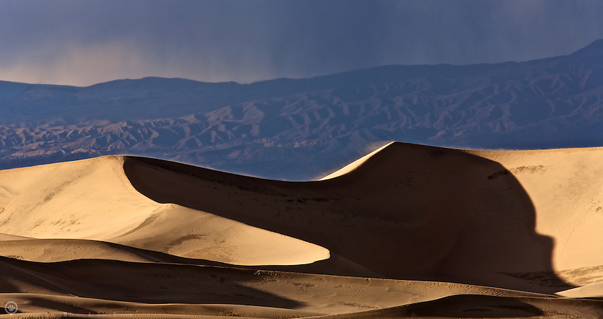 The last light of day kisses the sand dunes in Death Valley, California