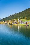 Oesterreich, Kaernten, Techendorf mit evangelischer Filialkirche: Herbststimmung am Weissensee | Austria, Carinthia, Techendorf with subsidiary church: autumn scenery at Lake Weissensee