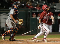 Arkansas pinch hitter Cullen Smith follows through Friday, April 2, 2021, with a sacrifice fly to score short stop Jalen Battles during the seventh inning of play against Auburn at Baum-Walker Stadium in Fayetteville. Visit nwaonline.com/210403Daily/ for today's photo gallery. <br /> (NWA Democrat-Gazette/Andy Shupe)