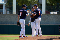 Third baseman Cody Schrier (8) fist bumps pitcher Chase Petty (4) and first baseman Tommy White (44) during the Baseball Factory All-Star Classic at Dr. Pepper Ballpark on October 4, 2020 in Frisco, Texas.  Pitcher Chase Petty (4), a resident of Somers Point, New Jersey, attends Mainland Regional High School.  (Mike Augustin/Four Seam Images)
