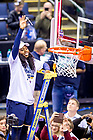 April 1, 2018; Arike Ogunbowale cuts a piece of the net following the Women's Basketball Final Four Championship Game. Notre Dame defeated Mississippi State 61-58. (Photo by Matt Cashore/University of Notre Dame)