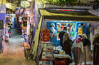 Chefchaouen, Morocco.  Neighborhood Sundries Shop in the Medina at Night.