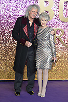 """Brian May and Anita Dobson<br /> arriving for the """"Bohemian Rhapsody"""" World premiere at Wembley Arena, London<br /> <br /> ©Ash Knotek  D3455  23/10/2018"""