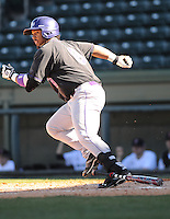Designated hitter Dale Urquhart (8) of the Western Carolina Catamounts in a game against the Cincinnati Bearcats on Sunday, February 24, 2013, at Fluor Field in Greenville, South Carolina. Cincinnati won in 10 innings, 7-6. (Tom Priddy/Four Seam Images)