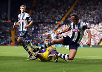 Sunday 01 September 2013<br /> Pictured:  Jonjo Shelvey of Swansea (on the ground) brings down Jonas Olsson of West Brom (R).<br /> Re: Barclay's Premier League, West Bromwich Albion v Swansea City FC at The Hawthorns, Birmingham, UK.
