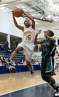 Rahneeka Saunders of Riverdale Baptist goes strong to the basket for two points over Amber Singletary of Seton Keough during the NHSI Championship game. Seton Keough won 44 - 42.